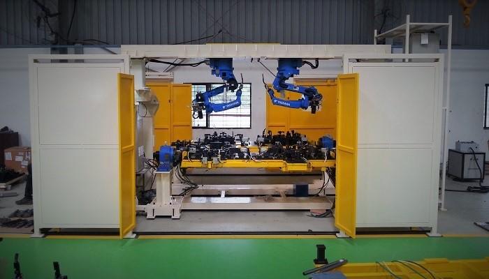 Papl Robotic Mig Welding Line With Changeover Fixtures